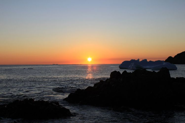Sunset Iceberg Newfoundland Canada Beauty In Nature Coastline Distant EyeEm Best Shots EyeEm Nature Lover Horizon Over Water Iceberg Landscape Light Ocean Outdoors Rippled Rock Rock Formation Scenics Sea Seascape Surf Tranquil Scene Vacation Vacations Water Wave