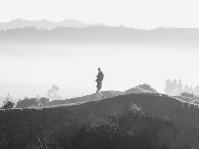 Live For The Story One Man Only One Person Only Men Adults Only Adult People Men Silhouette Standing Leisure Activity Outdoors Day Nature Rural Scene Full Length Mountain Sky Beauty In Nature