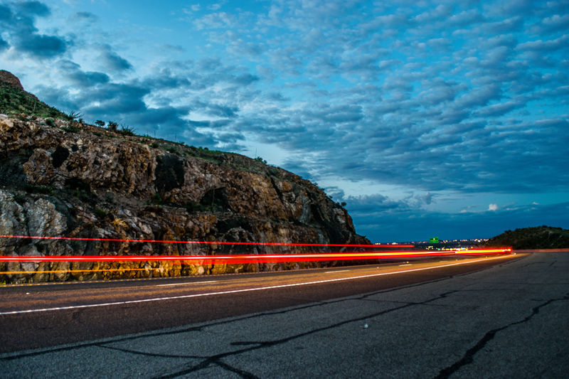 Blue Blurred Motion Cliff Cloud Illuminated Light Trail Long Exposure Motion Mountain Outdoors Road Sky Speed Tail Light