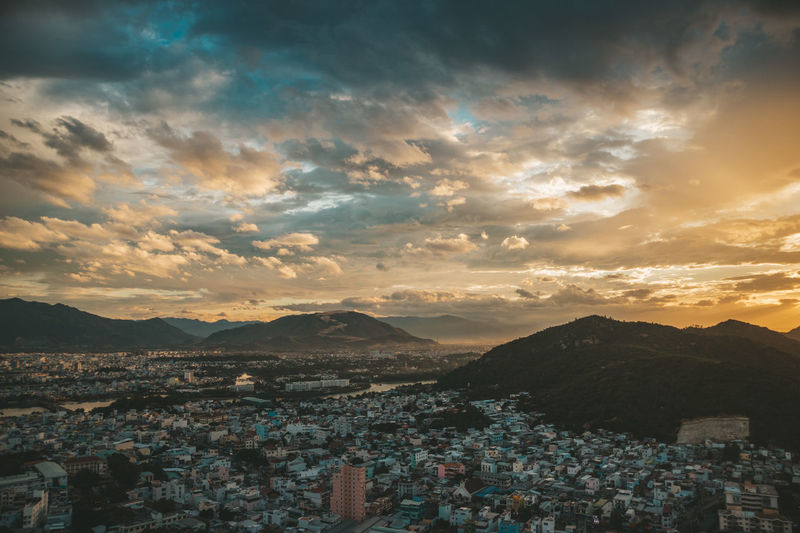 Nha Trang cityview on sunset Architecture Beauty In Nature Building Building Exterior Built Structure City Cityscape Cloud - Sky Community Crowd Crowded High Angle View Mountain Mountain Range Nature Outdoors Residential District Scenics - Nature Settlement Sky Sunset TOWNSCAPE