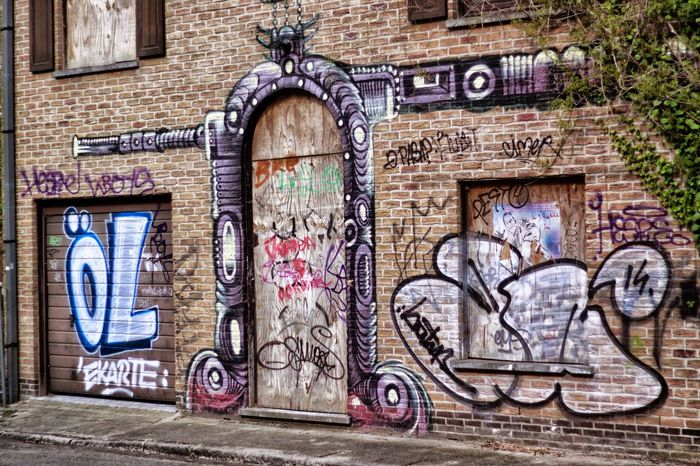 Graffiti Art And Craft Street Art Creativity Architecture Wall - Building Feature Built Structure Spray Paint Day No People Building Exterior Outdoors Doel Belgium