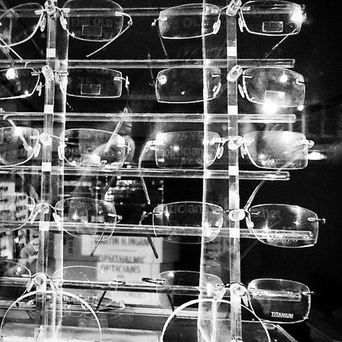 Lots of Glasses in an Opticians Shop Window display bw spectacles xperiaz3