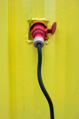 CEE Plug Electric Plug Electric Wire Plug Black Wire Built Structure Cee Close-up Day Metal No People Outdoors Red Wall - Building Feature Yellow