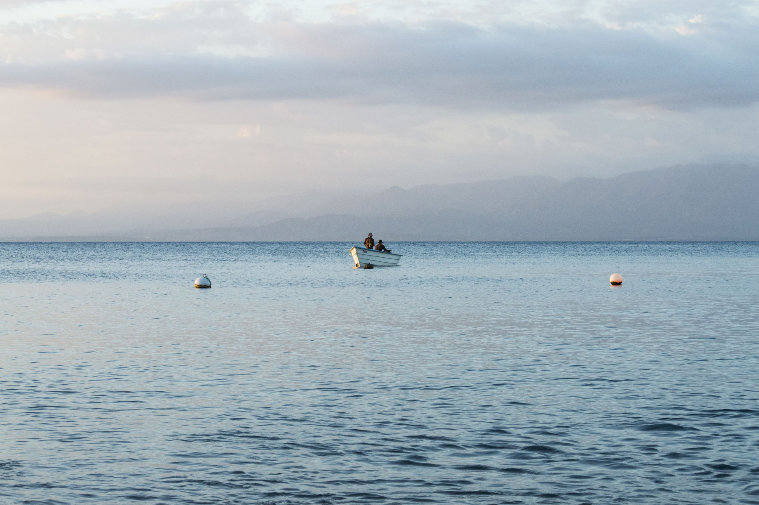 water, sea, nature, beauty in nature, cloud - sky, sky, scenics, waterfront, nautical vessel, tranquility, transportation, outdoors, day, horizon over water, mode of transport, no people, jet boat