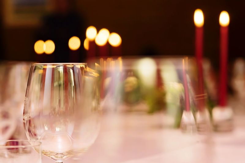 EyeEm Selects Glass Glass - Material Illuminated Wineglass Indoors  Focus On Foreground Drinking Glass Table Food And Drink Restaurant Bar - Drink Establishment Night Close-up Still Life Refreshment