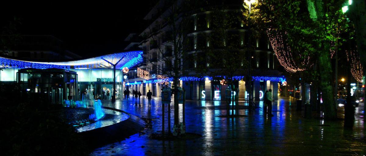 Panoramic view of illuminated building at night