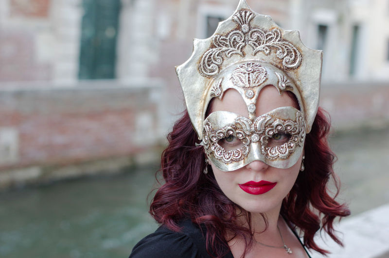 Close-Up Of Woman Wearing Venetian Mask