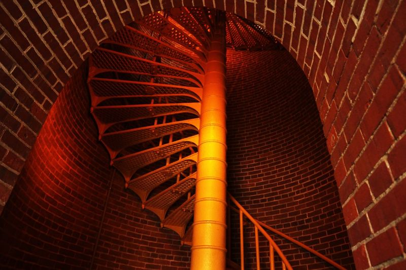 Spiral staircase Brick Brick Wall Low Angle View Built Structure Architecture No People Brick Pattern Metal Staircase Wall - Building Feature Wall Building Exterior Industry Day Steps And Staircases Orange Color Ceiling