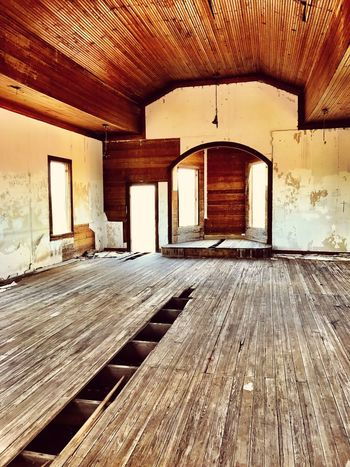 """To Reach Heaven You Must Cross The Void"" The interior sanctuary of the Taiban Presbyterian Church, built in 1908, lies alone and ghost like in the town of Taiban, New Mexico. Churches New Mexico Photography New Mexico Abandoned Buildings Abandoned Places Ghosttown Ghostly Wood Floor Interior Santuary Church Architecture Built Structure Building No People Sunlight Abandoned"