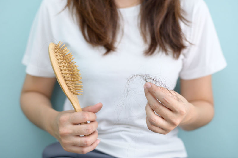 Hair loss in woman hands and comb. Adult Alopecia Backgrounds Sadness Serious Skin Diseases Chemotherapy Dandruff Cancer Women Young Adult White Background Unhappy Hair Fall Hair Loss Hair Hair Brush Strain Shock Shocked Hanging Out Head And Shoulders Scarf person Loose Losing Weight Medical Medicine Despair Hand Holding Unhealthy Lifestyle Healthy Eating Dermatology Females Fall Looking At Camera Sad Scared Panic Combine Harvester Brush Hair, Fur, Wool, Coat, Feather Fur Feather  Serious Face Gray Hair Worried Surprise Aged