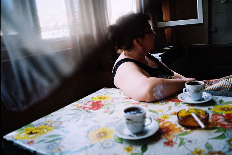 Analog Analogue Casual Clothing Coffee Colour Documentary Domestic Room Film Film Photography Flora Flowers Home Indoors  Interior Kodak Lashafox Leisure Activity Lifestyles Portrait Relaxation Sitting Smoking Tsertsvadze Window Woman