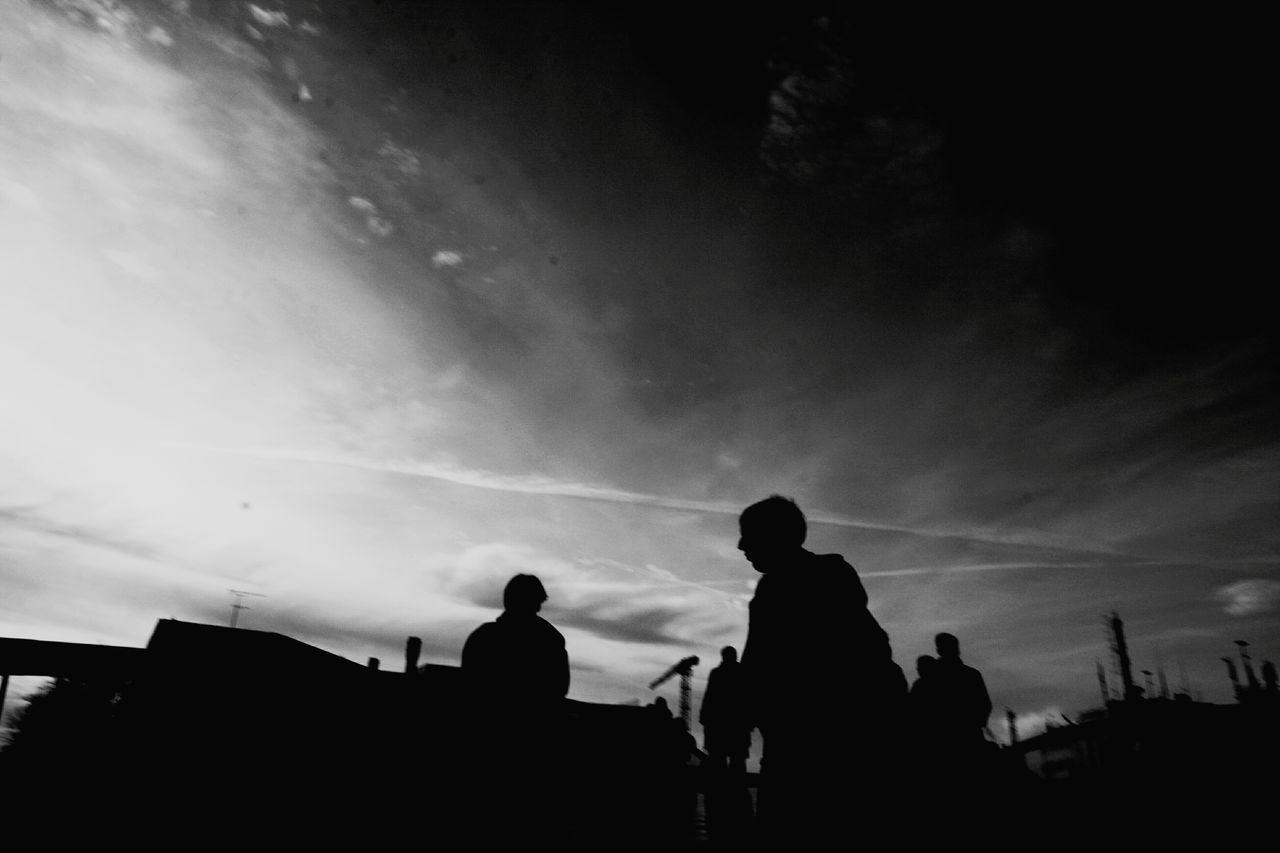 SILHOUETTE OF MEN AGAINST SKY