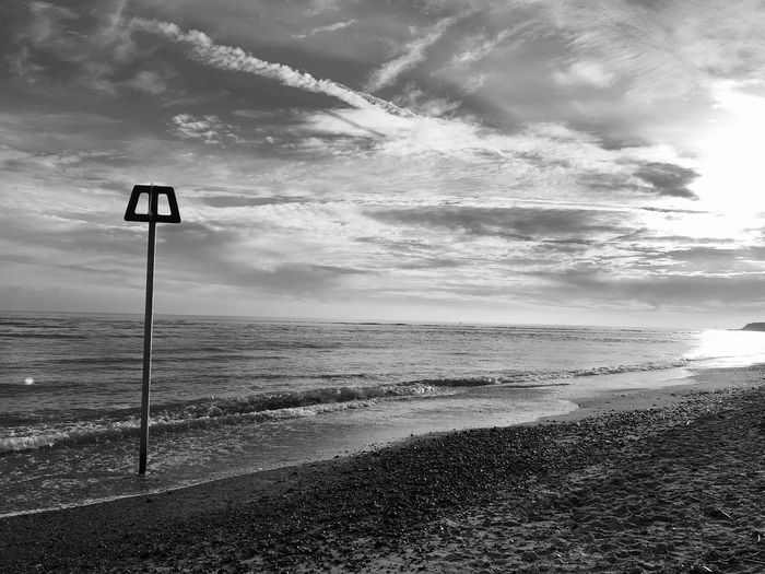 Winter sunshine Sky Cloud - Sky Tranquil Scene Land Beauty In Nature Tranquility Scenics - Nature Water Sea Nature Beach Horizon Over Water Idyllic No People Horizon Outdoors Day Sign Sunlight