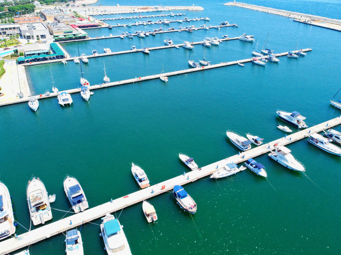 Aerial view of sailboats moored in sea