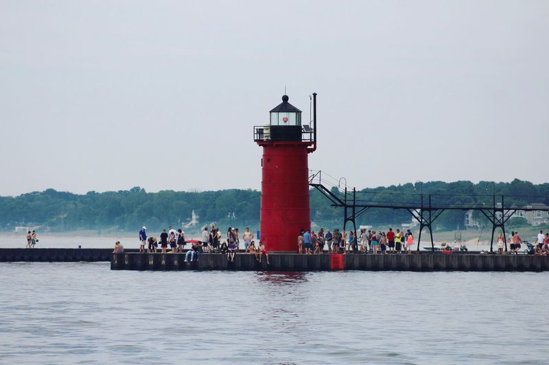 Safety Lighthouse Security Water Protection Large Group Of People Waterfront Built Structure Architecture Day Clear Sky Sea Sky Nature Outdoors Building Exterior Men Real People Scenics Nautical Vessel Taking Pictures Live For The Story Lighthouse_lovers Lighthouses Of Lake Michigan Lighthouse_captures