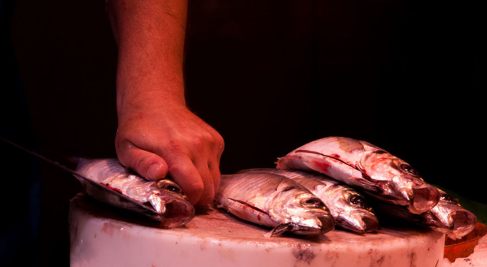 Food Fish Eating Dead Cutting Board Knife Food And Drink Human Body Part Freshness Human Hand Raw Food Hand Indoors  Meat Seafood Healthy Eating Preparing Food Black Background Blood Boqueria