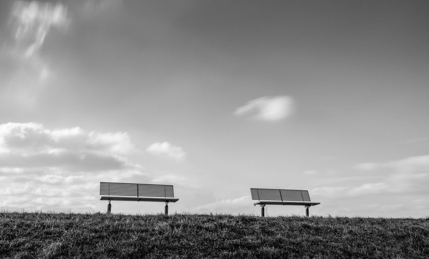 Heavenly waiting room. Bench Black & White EyeEm Best Shots EyeEm Selects EyeEm Gallery Grass Rhein Rheindamm Tranquility Beauty In Nature Black And White Blackandwhite Clouds Dam Monochrome No People Sky Tranquil Scene