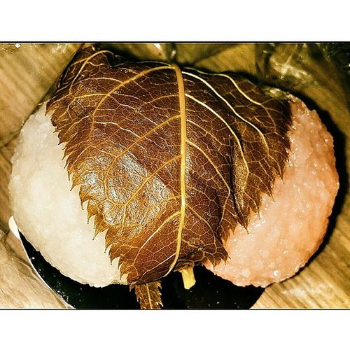 Sakuramochi is a Japanese Sweet consisting of sweet pink-coloured rice cake with a red bean paste centre, wrapped in a Pickled Cherry Blossom Leaf. Rice -flour or glutinous rice flour is used. It is traditionally eaten in spring, particularly on Girls' Day (hinamatsuri) and Hanami.