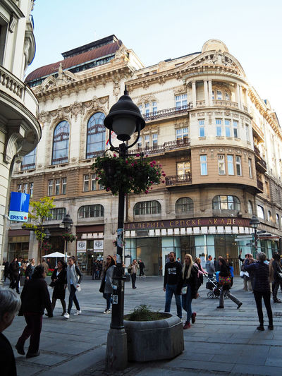 European Cities Belgrade Serbia Eastern Europe Balkans Europe Outdoors Lifestyles Men Adult Real People Architecture Building Exterior Built Structure Group Of People City Day Walking City Life Pedestrian Zone Travel Destinations Street Photography Historical Building Plants And Flowers Sky Lamp Post