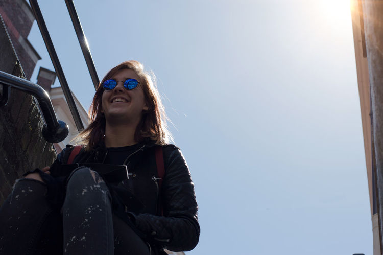 Casual Clothing Confidence  Day Front View Headshot Leisure Activity Lifestyles Long Hair Outdoors Person Portrait Sky Smiling Toothy Smile Young Adult