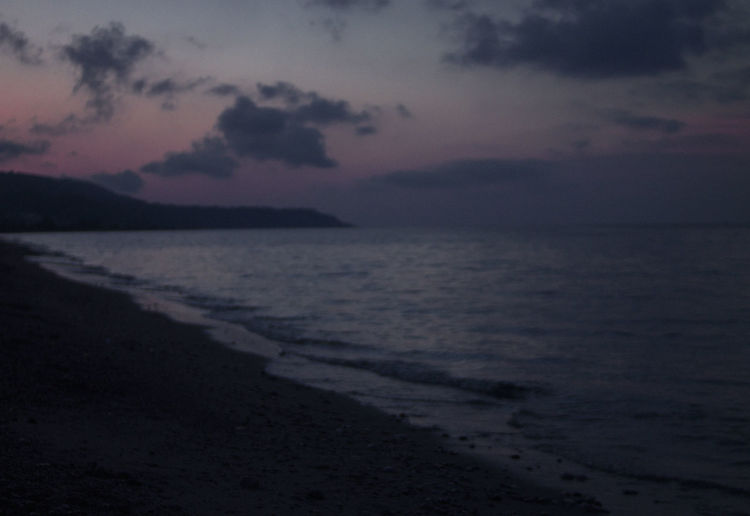 Sky Sunset Cloud - Sky Tranquility Beauty In Nature Water Scenics - Nature Sea Land Beach Tranquil Scene Nature No People Dusk Horizon Outdoors Silhouette Horizon Over Water Mountain Contemplation