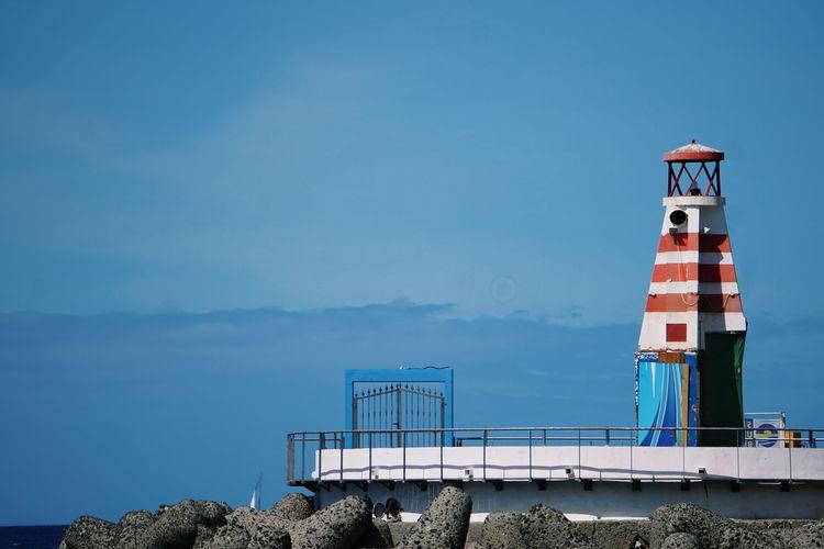 Lighthouse against clear blue sky