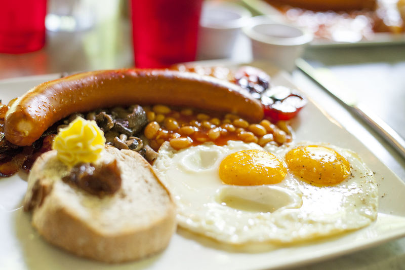 Close-up of english breakfast served in plate on table