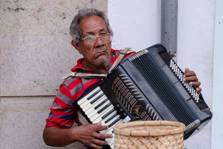Senior man playing accordion