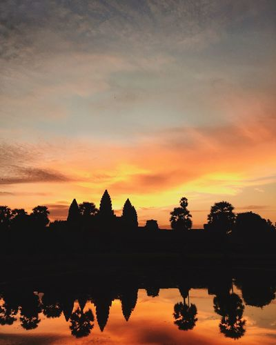 Ankor Thom Ankor Wat Cambodia Cambodia Photos Ankorwat Beauty In Nature Cambodia Tour Cambodian Cloud - Sky Nature No People Orange Color Outdoors Place Of Worship Reflection Scenics - Nature Silhouette Sky Sunrise Tranquil Scene Tranquility Tree Water Waterfront