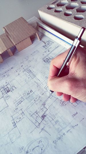 Cropped image of architect making blueprint