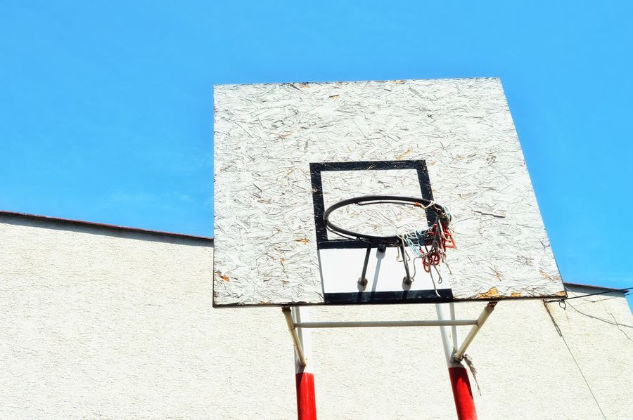 Basketball Basketball - Sport Basketball Hoop Blue Clear Sky Close-up Day Geometric Shape Geometric Shapes Leisure Activity Leisure Games Lifestyles Low Angle View Net - Sports Equipment Outdoors Sky Sport Sport In The City Sunlight Urban Lifestyle