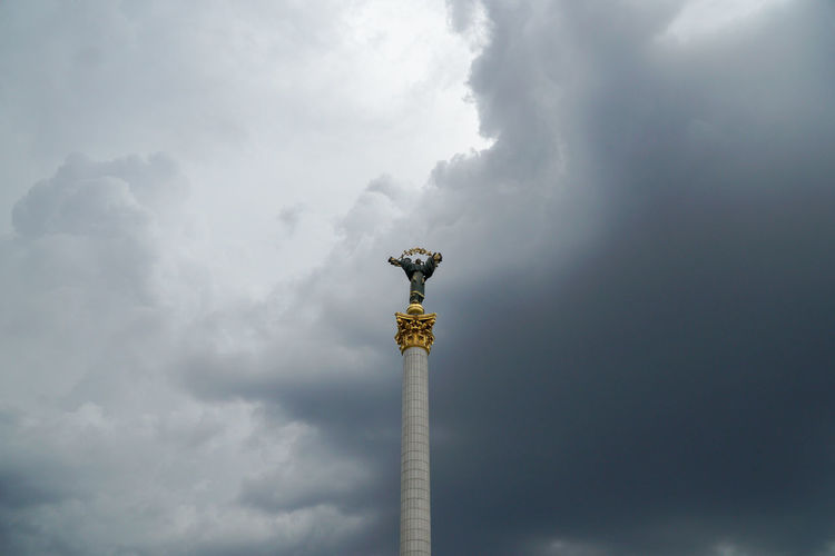 Travel Vacation Architectural Column Travel Destinations Tall - High Dramatic Sky Cloud - Sky The Past Built Structure Statue Monument Memorial Tower Low Angle View Architecture Art And Craft Outdoors