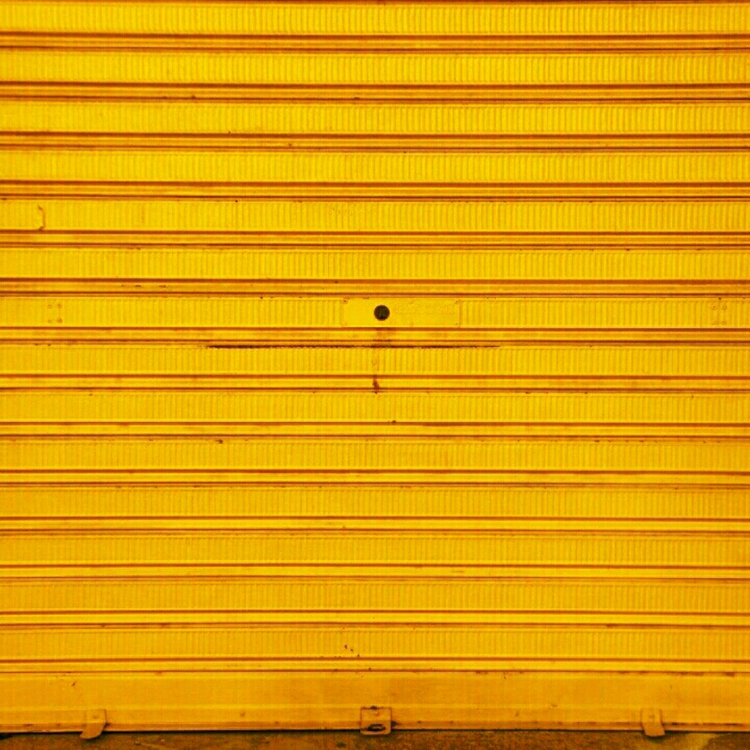 full frame, backgrounds, yellow, pattern, textured, built structure, architecture, repetition, wall - building feature, design, close-up, wall, metal, closed, protection, no people, building exterior, detail, metallic, safety