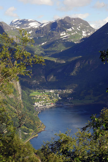 Cloud - Sky Day Fjord Fjordland Geiranger Geirangerfjord Landscape Mountain Mountain Range Nature No People Norway Outdoors Sky Snow Sunlight Tree Vertical Water