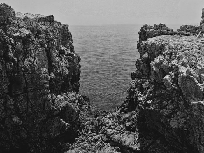 Blackandwhite Black And White Black & White No People Day Daylight Tranquil Scene Tranquility Water Sea Beach Sky Horizon Over Water Rock Formation Coast Geology Cliff Rock - Object Rocky Coastline Rock Stack Rock