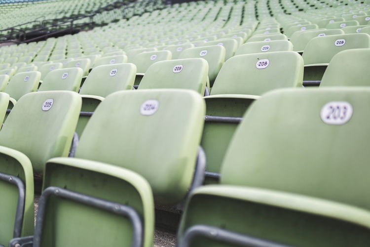 Close-up of empty seats in stadium