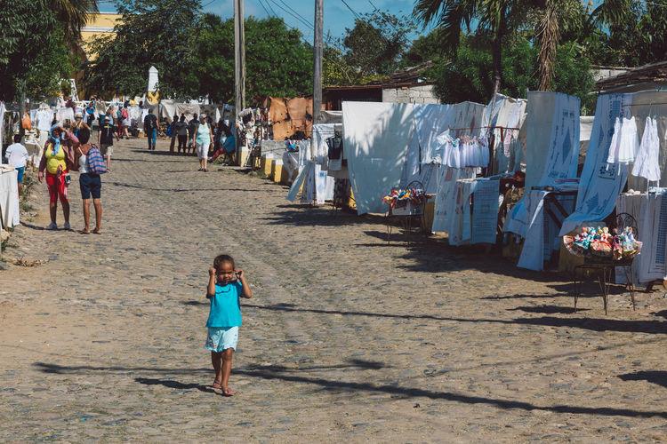Women walking on zebra crossing