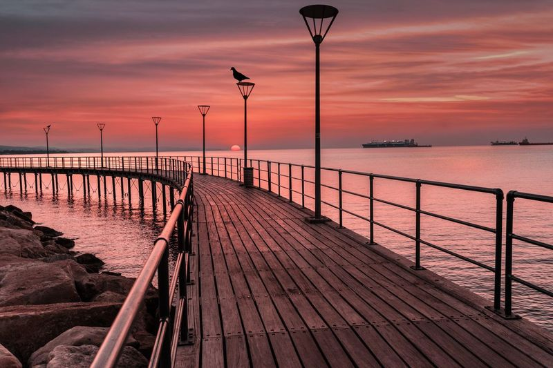 Sunset is my favourite colour...🔥❤️💥 Sunset Water Sea Nature Sky Like4like Follow Follow4follow Nature Photography Scenics Outdoors Horizon Over Water Tranquil Scene Railing Tranquility Pier Jetty No People Cloud - Sky Street Light Wood Paneling Day