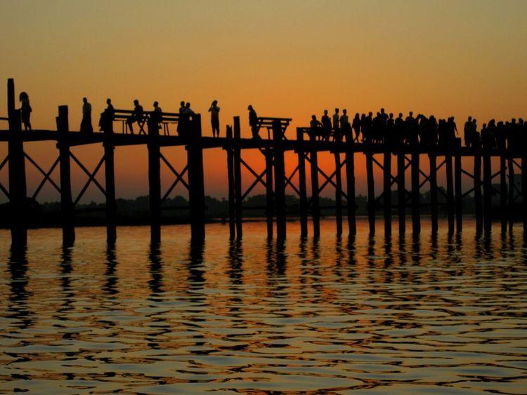 People love to watch sunset at U Bein Bridge, Mandalay, Myanmar. Taking Photos Hello World Relaxing Enjoying Life Mandalay Myanmar Sunset The _ Mazzalong Romance Asian Culture Ubeinbridge Asian  Myanmar View Myway Sky