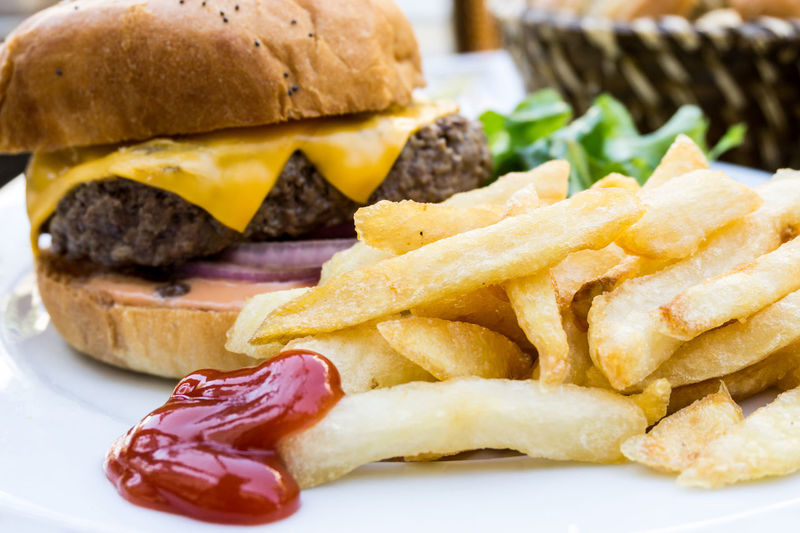 Close-up of burger with french fries in plate