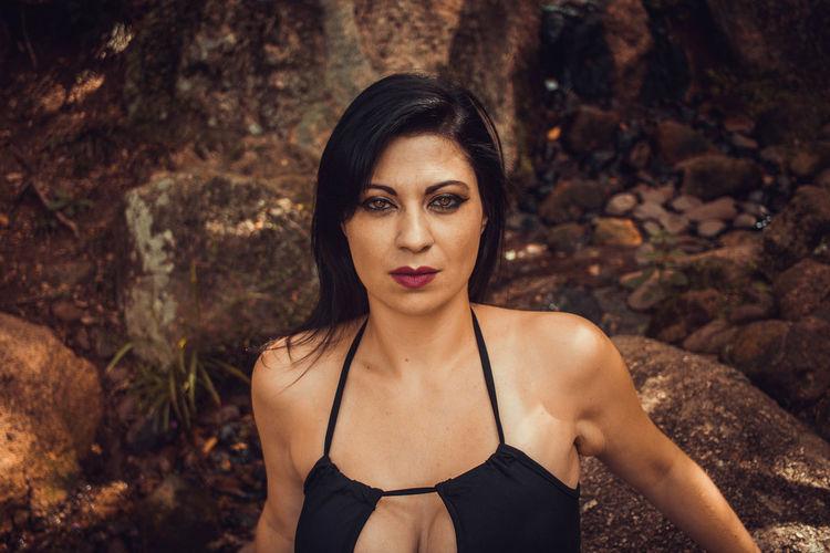 Portrait of woman on rock