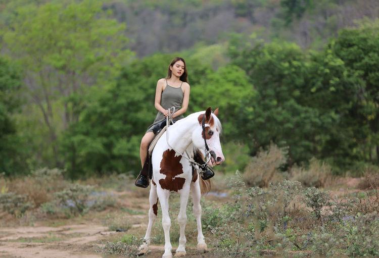 Full length of man riding horse