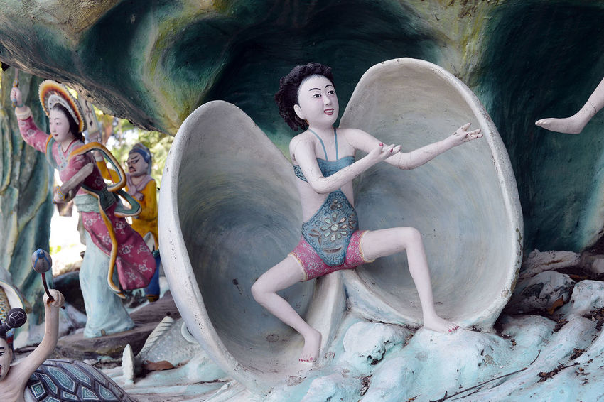 Scenes from Haw Par Villa in Singapore Adult Adults Only Beauty Chinese Day Elephant Folklore Fragility Full Length Grace Hell Legends Mythology One Person Only Women Outdoors People Shell Singapore Statue Strange Theme Park
