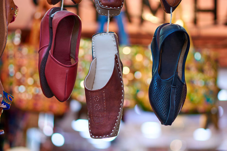 Close-up of shoes hanging at market stall