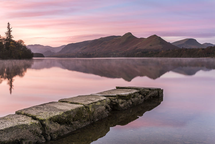 The old Jetty bathed in morning colour at Isthmus Bay - Derwent water Callander Peace Beauty In Nature Brochure Broken Colour Day Idyllic Jetty Lake Lake View Landscape Mountain Nature No People Old Outdoors Reflection Scenics Sky Sunrise Sunset Tranquil Scene Tranquility Water