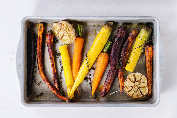 Dinner Time Garlic Herbs Tray Baked Carrots Carrot Carrots Colorful Vegetables Colors Of Food Different Directly Above Food Grilled Vegetables Healthy Eating Healthy Food Top View Of Food Variety Vegan Food Vegetables Veggies White Background Yellow Carrots