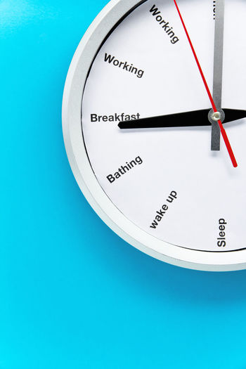 Close-up of clock over blue background