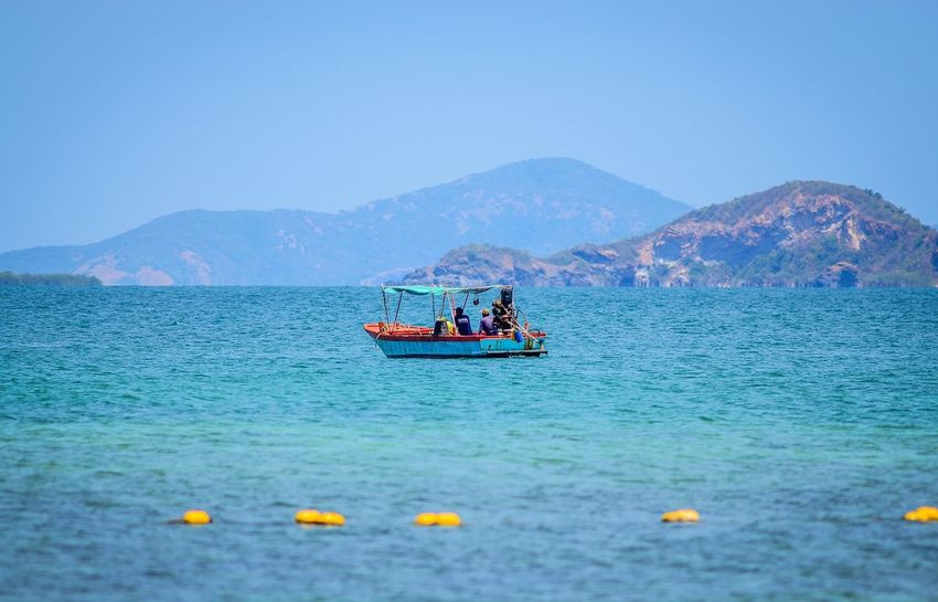 Beauty In Nature Blue Boat Clear Sky Day Journey Mode Of Transport Mountain Mountain Range Nature Nautical Vessel No People Non-urban Scene Outdoors Rippled Sailing Scenics Sea Seascape Tranquil Scene Tranquility Transportation Water Waterfront เกาะขา
