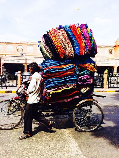 Capture The Moment Man in Japiur, India is pushing his bike with s heavt load. India Japiur Streetphotography The Street Photographer - 2016 EyeEm Awards Colours Man At Work Heavy Load Street City Life Feel The Journey The Color Of Business Small Business Heroes