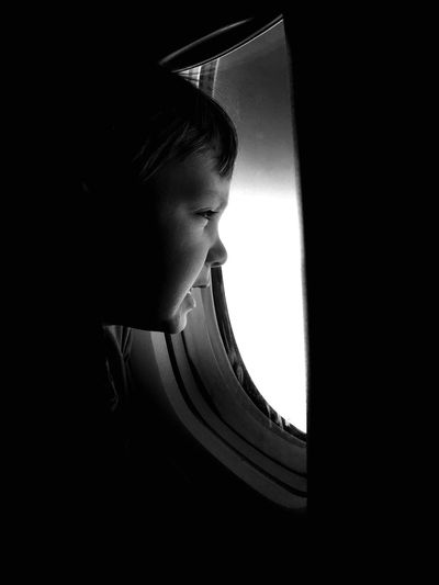 A little boy looking through the window. Aeroplane Plane Americanairlines Travel Photography Travel Destinations Traveling USA USAtrip Miami Worldwide Worldwide_shot Blackandwhite Photography Boy
